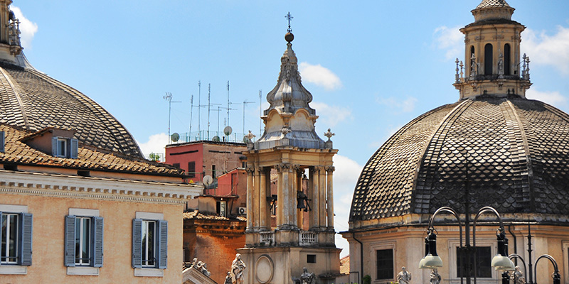 View of Bell Tower and Dome of Santa Maria dei Miracoli Church in Rome